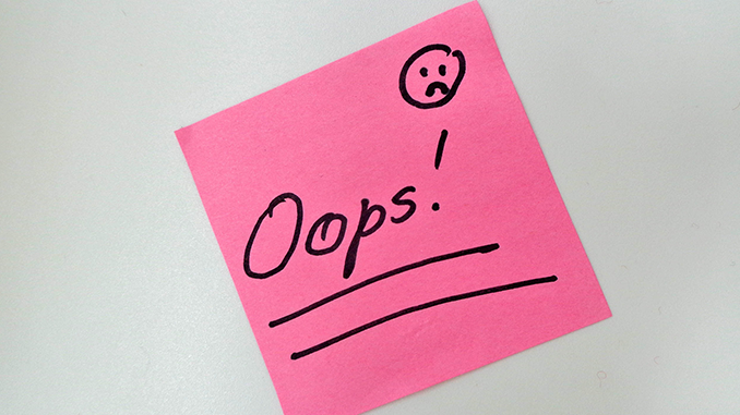 'Oops' sticky note with frowny face